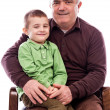 Stock Photo: Portrait of grandpwith his happy grandson sitting in armchai