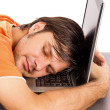 Young man taking a nap on his laptop — Stock Photo