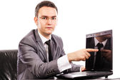 Young businessman presenting something on his laptop — Stock Photo