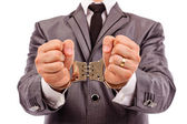 Businessman's hands with handcuffs — Stock Photo