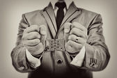 Portrait of a businessman's hands with handcuffs — Stock Photo