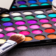 Make-up colorful eyeshadow palettes with makeup brush — Stock Photo