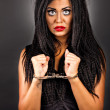 Foto Stock: Portrait of expressive young womwith handcuffs-creative ma