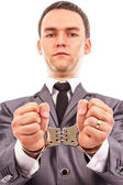 Closeup portrait of a young businessman with handcuffed hands — Stock Photo
