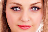 Face of a beautiful young woman with blue eyes — Stock Photo