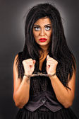 Portrait of an expressive young woman with handcuffs-creative ma — Stock Photo