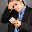 Portrait of a young businessman with strong headache — Stock Photo #33554757