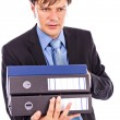 Stock Photo: Young businessmholding many folders