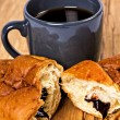 Morning breakfast with cup of coffee and croissant — Stock Photo