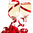 Foto Stock: Glasses with champagne and red ribbon