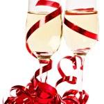 Gläser mit Champagner und red ribbon — Stockfoto