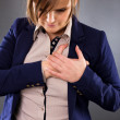 Portrait of a young businesswoman having a pain in the heart are — Stock Photo