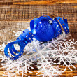 Blue christmas ball with ribbon — Stock Photo