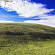 Beautiful nature landscape with clouds and green hills — Stock Photo #37978141