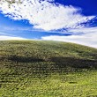 Beautiful nature landscape with clouds and green hills — Stock Photo