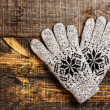 Grey knitted winter gloves — Stock Photo #37978157