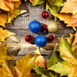 Autumn leaves and Christmas ornaments — Stock Photo