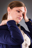 Closeup portrait of a young businesswoman suffering from neck pa — Stock Photo