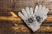 Grey knitted winter gloves — Stock Photo
