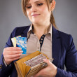 Portrait of a smiling businesswoman holding her wallet and credi — Stock Photo #40002417