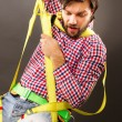 Stock Photo: Young mwearing fall protection harness and lanyard for wor