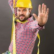 Young construction man with hard hat wearing a fall protection — Stock Photo