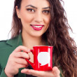Closeup portrait of a happy businesswoman holding a cup of coffe — Stock Photo
