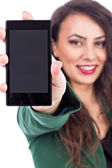 Beautiful young woman showing her smart phone screen — Stock Photo
