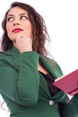 Portrait of a beautiful young woman holding a book — Stock Photo
