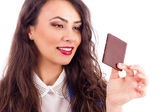 Beautiful woman tempted by chocolate  — Stock Photo