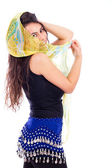 Beautiful young woman with a shawl partially covering her face o — Stock Photo