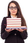 Portrait of a young serious teacher with glasses holding books — Stock Photo