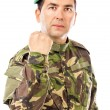 Serious young soldier with arm raised showing his fist — Stock Photo #46353209