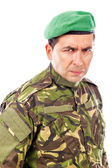 Portrait of an angry soldier with green beret — Stock Photo