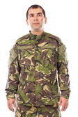 Portrait of a young soldier looking at camera isolated — Stock Photo