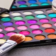 Make-up colorful eyeshadow palettes with makeup brush — Stock Photo #46414463