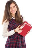 Adorable estudiante sosteniendo una pila de libros — Foto de Stock