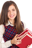Closeup portrait of happy student  holding a pile of books  — Stock Photo