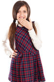 Portrait of embarrassed schoolgirl holding hand over her mouth — Stock Photo