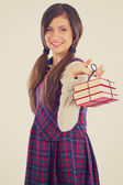 Happy adorable student  holding a pile of books — Stock Photo