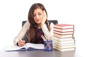 Portrait of  bored schoolgirl doing his homework at  desk — Stock Photo
