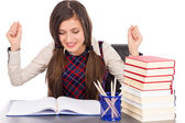 Happy student sitting at desk, hands in the air — Stock Photo