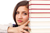 Closeup of  student face behind stack of books — Stock Photo