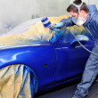 Worker painting a car. — Stock Photo