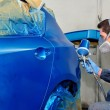 Worker painting a car. — Stock Photo #13710273