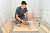 Assembling a table. — Stock Photo