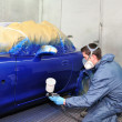 Worker painting a car. — Stock Photo #14046651