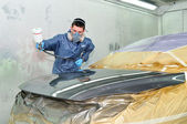 Worker painting a car. — Foto Stock