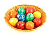 Painted eggs in a basket — Stock Photo