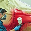 Worker painting a car — Stock Photo #18020999